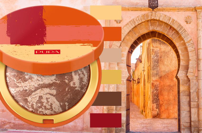 terra cotta pupa su sfondo marrakech